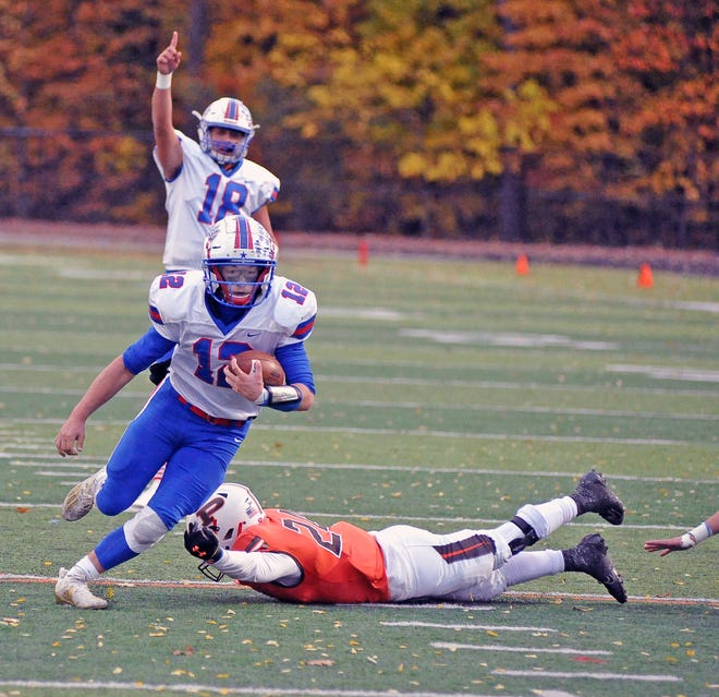 West Holmes' Peyton McKinney celebrates as Noah Clark nears the end zone during the Knights' big win over Padua Franciscan in the Div. III playoffs.