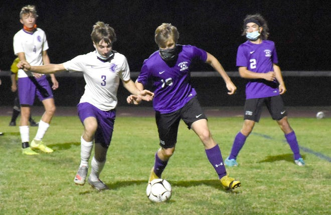 West Canada Valley's Cole Youngs and Little Falls/Dolgeville's Tucker Rockwell (from left) converge on a loose ball during the first half of Friday's match in Little Falls, New York.