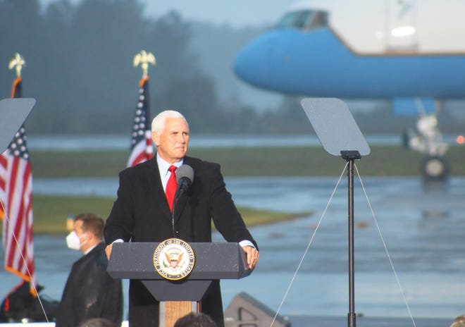 Vice President Mike Pence speaks to a crowd at the Kinston Regional Jetport Sunday, October 25, during a Make America Great Again! Victory Rally. [Brandon Davis/Kinston Free Press]