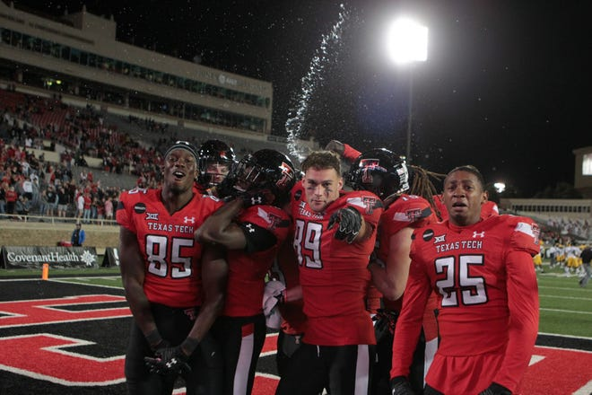Texas Tech players celebrate after their 34-27 victory against West Virginia on Saturday at Jones AT&T Stadium. The Red Raiders had lost six times since the start of the 2019 season when they led at the end of the third quarter or later.