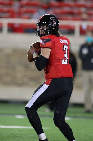 Texas Tech quarterback Henry Colombi sets up to pass during the Red Raiders' 34-27 victory Saturday against West Virginia at Jones AT&T Stadium. Colombi made his first career start, passing for 169 yards and rushing for 40.