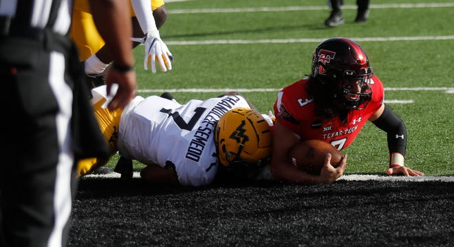 Texas Tech's Henry Colombi scores a touchdown in the first half of a Big 12 Conference game Saturday against West Virginia at Jones AT&T Stadium. Colombi, who was making his first start finished with 169 yards and one touchdown in the win.