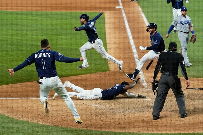 The Tampa Bay Rays celebrate after winning Game 4 of the World Series against the Los Angeles Dodgers on Saturday in Arlington, Texas.