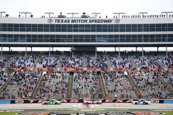 Kevin Harvick (4), Brad Keselowski (2) and Alex Bowman (88) pass the grandstand on the front stretch of a NASCAR Cup Series auto race at Texas Motor Speedway in Fort Worth, Texas, on Sunday.