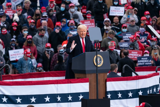 President Donald Trump speaks at a campaign rally at Manchester-Boston Regional Airport on Sunday in Londonderry, N.H.