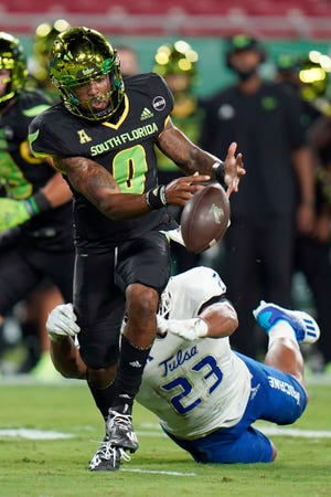 South Florida quarterback Noah Johnson (0) fumbles the football after getting hit by Tulsa linebacker Zaven Collins (23) during the first half Friday in Tampa. Tulsa recovered the fumble.