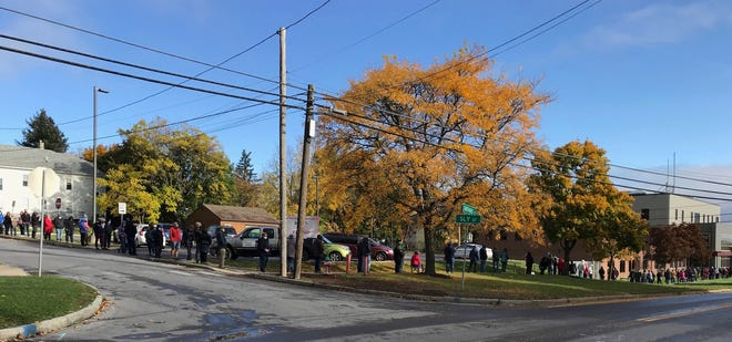 Voters form a line that wraps around the block outside the Ontario County Board of Elections Saturday, the first day of early voting that continues through Sunday, Nov. 1. The early election site opened at 9 a.m. Saturday. The photo was taken on Saturday, Oct. 24, at 10:24 a.m.