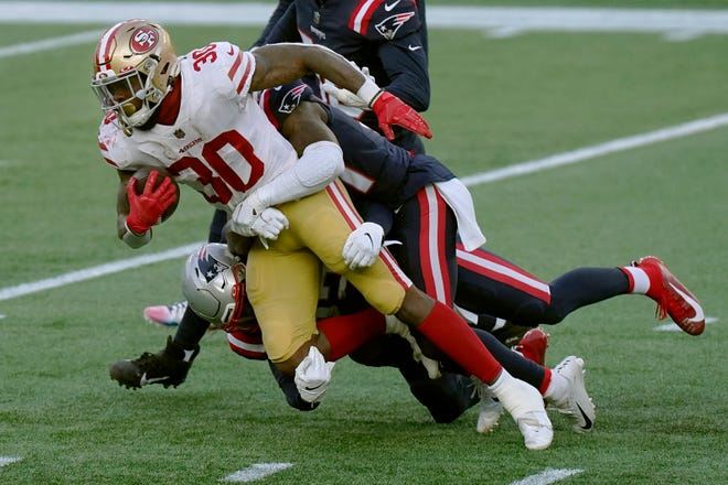 Jeff Wilson had a career night as the San Francisco 49ers mopped the floor with the New England Patriots, 33-6.