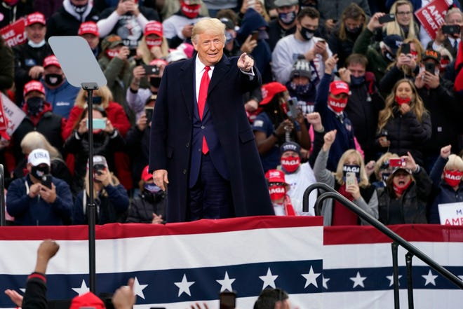 President Donald Trump arrives to speak during a campaign rally at Manchester-Boston Regional Airport, Sunday, Oct. 25, 2020, in Londonderry, N.H. (AP Photo/Elise Amendola)