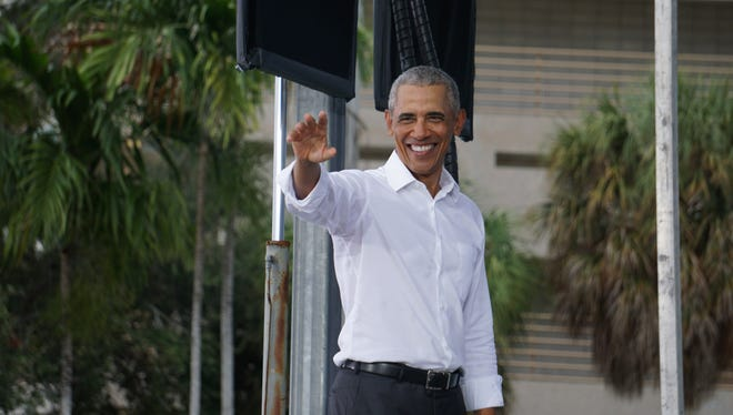Barack Obama waves to supporters in Miami at a drive-in rally for Joe Biden and Kamala Harris. Oct. 24, 2020.