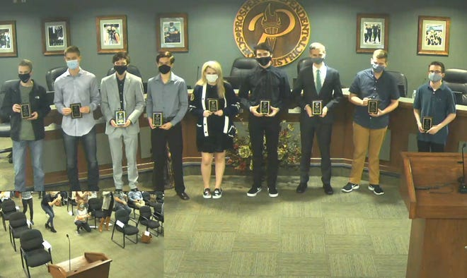 Merit Scholarship  award recipients pose together during the recent meeting of the Prosper Independent School District.