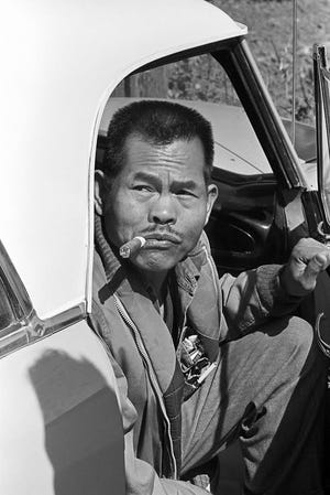 Larry Itliong, arriving for a union meeting in the 1960s.