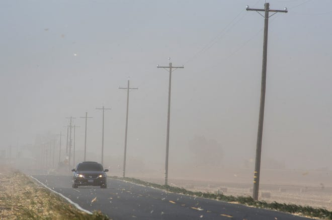 High sustained winds from 25-40 mph create a dust storm on Eight Mile Road west of Interstate 5 in Stockton one year ago.