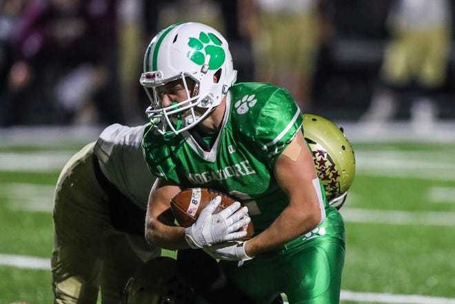 Mogadore senior Nick Skye runs with ball during Saturday night's playoff battle with Pymatuning Valley,