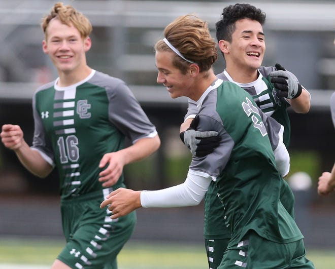 Grady Angerman (center) of Central Catholic celebrates his goal with teammates James Bown (16) and Christian Pena-Escobar (right) during their Division III sectional final against Rittman at Central Catholic on Saturday, Oct. 24, 2020.