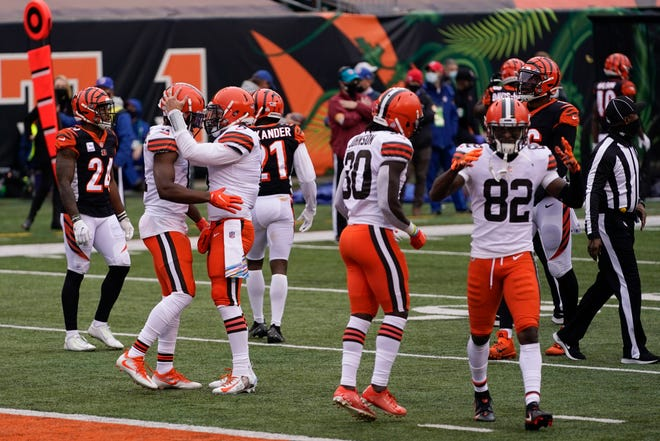 Cleveland Browns quarterback Baker Mayfield (6) talks with wide receiver Donovan Peoples-Jones after Peoples-Jones' touchdown reception during the second half of an NFL football game against the Cincinnati Bengals, Sunday, Oct. 25, 2020, in Cincinnati. (AP Photo/Bryan Woolston)