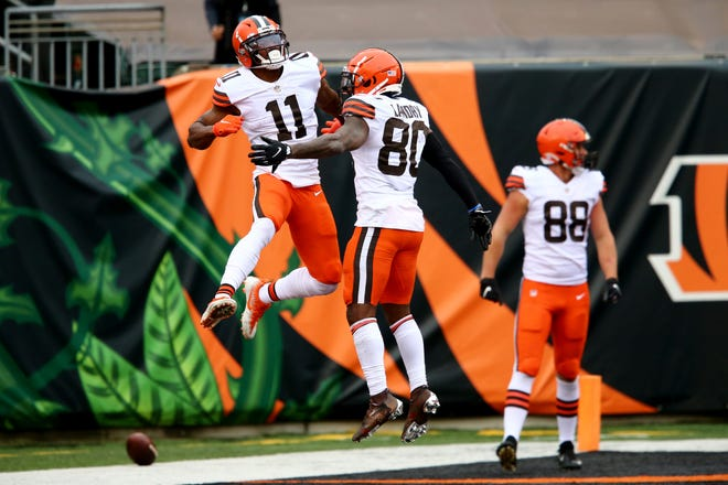 Browns receiver Donovan Peoples-Jones (11), left, celebrates his game-winning touchdown catch with teammate Jarvis Landry (80) during the fourth quarter of a win over the Bengals at Paul Brown Stadium in Cincinnati, Oct. 25, 2020.