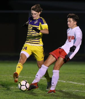 Marco Gagliardi (left) of Jackson defends against Stefan Lechintan of Geneva in their Division I sectional final at Jackson on Saturday, Oct. 24, 2020.