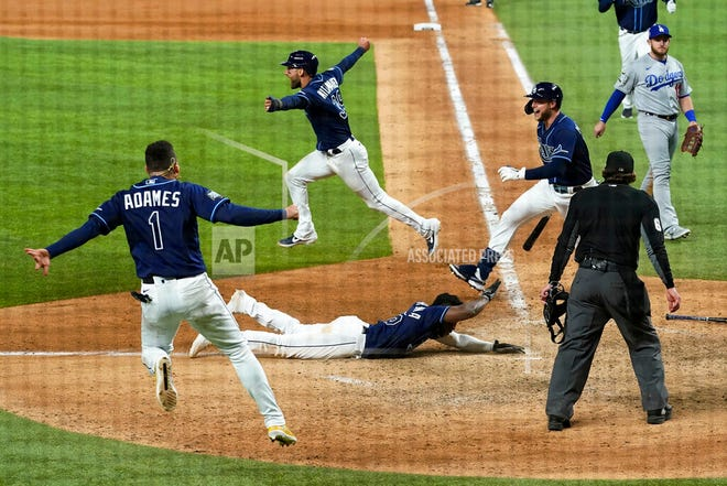 Tampa Bay's Randy Arozarena scores the winning run during the 9th inning in Game 4 of the baseball World Series  in Arlington, Texas. The Rays defeated the Los Angeles Dodgers 8-7 to tie the series 2-2 games.