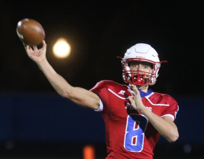 Garaway quarterback Garrett Newsome throws a pass in the game against Bellaire Saturday.