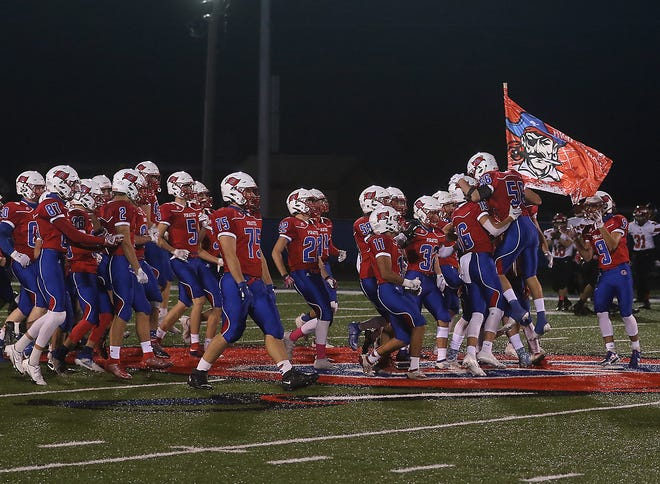 The Garaway Pirates take the field against Bellaire last Saturday night.