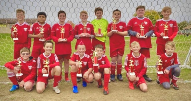 The Dover Soccer Association ComDoc U12 boys team won the U12 Boys Greater Akron Soccer League Championship with a record of 7-0-1. The team members are FRONT Ethan Bowman, Mason Locke, Kash Roth, Karson Baggozzi, Hunter Sanders, Blake Conrad. BACK Gavin VanHorn, Jerson Baten Hernandez, Gavin Mastroine, Jacob Noretto, Cooper Connare, Anthony Rennicker, Caden Gribble, Deacon Wise. Missing is Gavin Burrier. Head Coach Ethan Wherley, Assistant Coach Mike Davis, and Steve Van Horn guided the team.