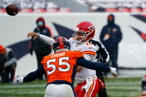 Kansas City Chiefs quarterback Patrick Mahomes, right, throws a pass under pressure from Denver Broncos outside linebacker Bradley Chubb during the first half on Sunday at Empower Field at Mile High in Denver. (AP Photo/Jack Dempsey)
