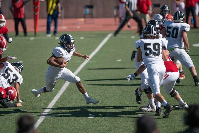 South High School's George Longoria breaks through on a run against Centennial on Saturday October 24, 2020 at Dutch Clark Stadium.
