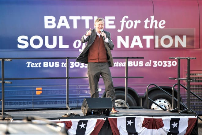 Former Colorado governor and U.S. Senate candidate John Hickenlooper speaks at a drive-in rally for Joe Biden and Kamala Harris at the Colorado State Fairgrounds Saturday.