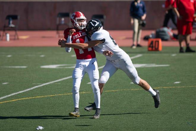 Centennial High School's Tyler Sanchez takes a hit from South's Brock Montoya Saturday October 24, 2020 at Dutch Clark Stadium.