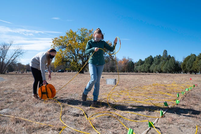 Colorado School of Mines students Sigourney Burch, left, and Hannah Haugen lay wire for what was a search for a possible mass grave at Roselawn Cemetary on Saturday October, 24.