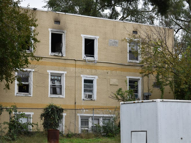 Tenants jumped from the upper floors of an apartment building during a fire early Sunday, according to a neighbor's account.