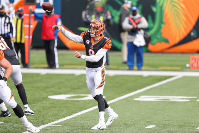Cincinnati Bengals quarterback Joe Burrow (9) throws a pass against the Cleveland Browns in the first half at Paul Brown Stadium on Oct. 25.