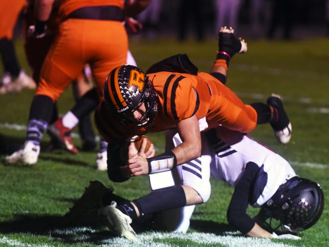 Gabe Tingle dives into the end zone during the first quarter of Ridgewood's 43-7 win against Baltimore Liberty Union on Saturday in a Division V, Region 19 quarterfinal in West Lafayette.