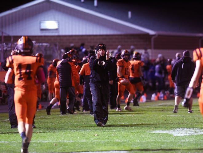 Head coach John Slusser gives his approval after his defense gets a stop during host Ridgewood's 43-7 win against Baltimore Liberty Union on Saturday in a Division V, Region 19 quarterfinal in West Lafayette.