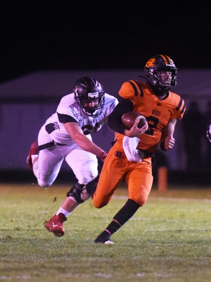 Gabe Tingle runs away from a defender en route to a punt return for a touchdown during host Ridgewood's 43-7 win against Baltimore Liberty Union during a playoff game. Tingle was named the IVC South Division Player of the Year.