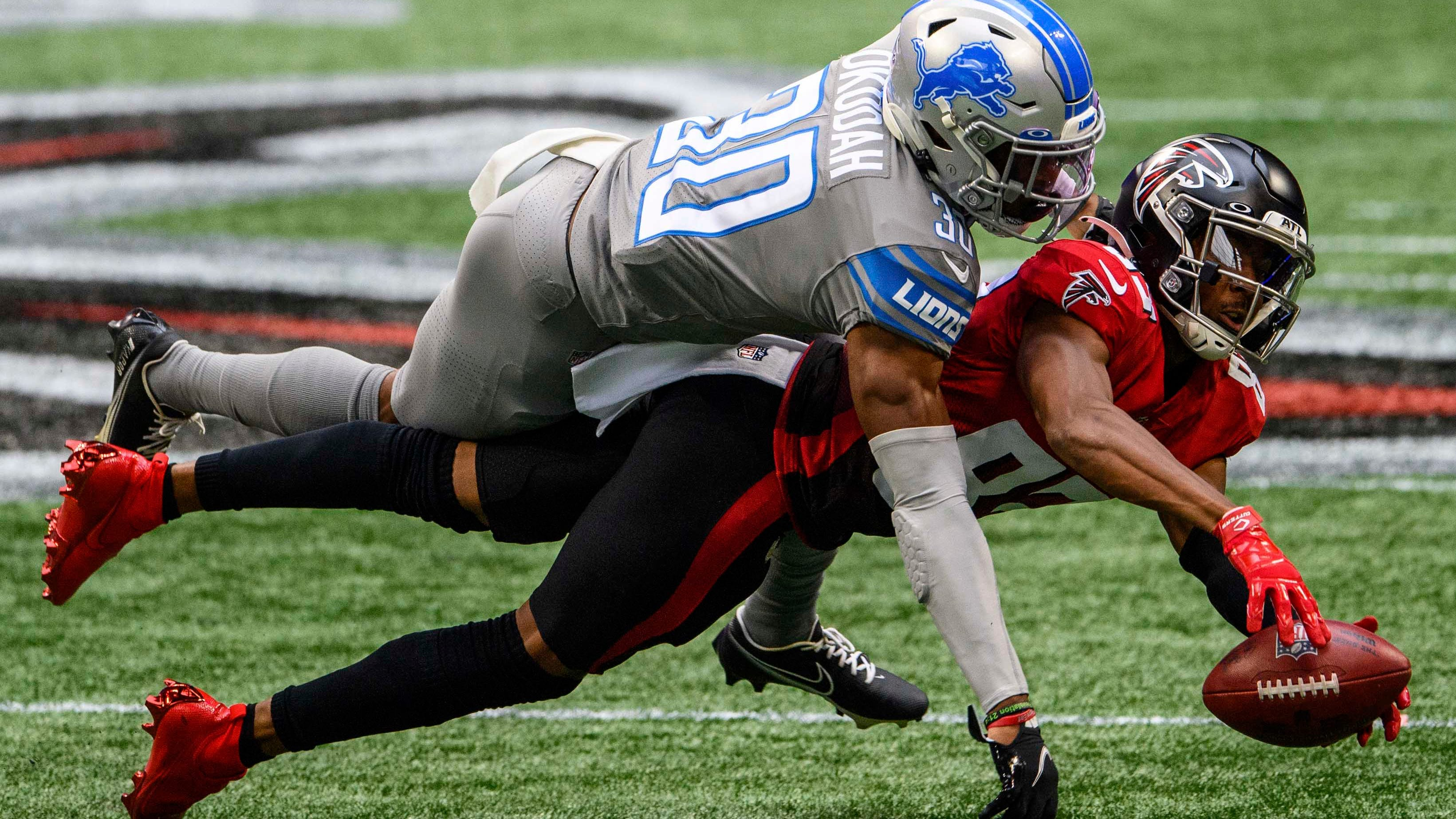Atlanta Falcons wide receiver Russell Gage (83) can't make the catch as Detroit Lions cornerback Jeff Okudah defends.
