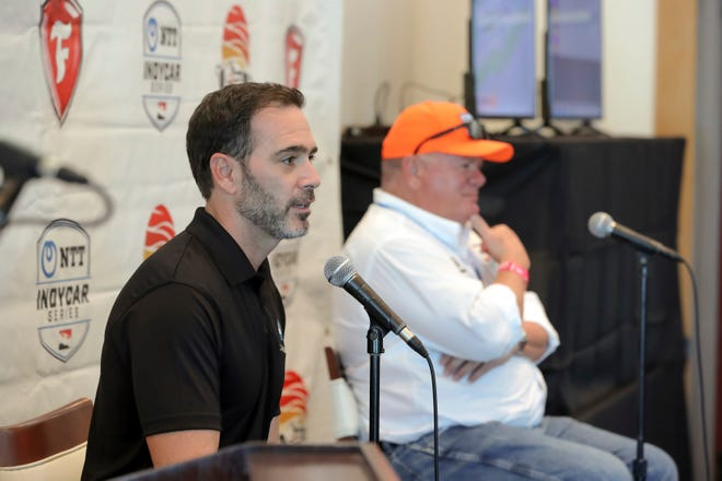 Jimmie Johnson, left, speaks about joining the team of Chip Ganassi, right, for the IndyCar series at a press conference during the IndyCar race weekend Saturday, Oct. 24, 2020, in St. Petersburg, Fla.