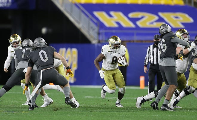 Oct 24, 2020; Pittsburgh, Pennsylvania, USA;  Notre Dame Fighting Irish running back Jafar Armstrong (8) runs the ball against the Pittsburgh Panthers during the fourth quarter at Heinz Field. The Notre Dame Fighting Irish won 45-3. Mandatory Credit: Charles LeClaire-USA TODAY Sports