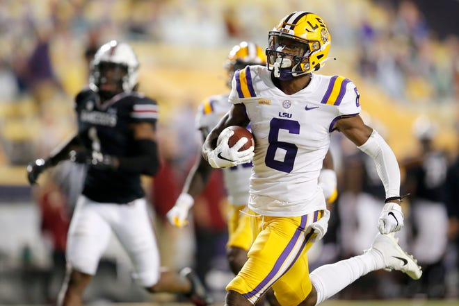 LSU wide receiver Terrace Marshall Jr. (6) runs the ball for a touchdown against South Carolina during the first half of an NCAA college football game in Baton Rouge, La. Saturday, Oct. 24, 2020.