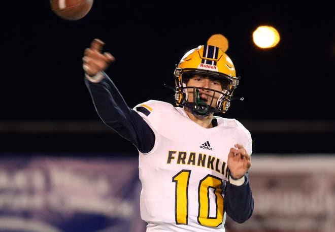 Franklin County's Nick Broyles (10) throws a pass during their game against Central in Frankfort, Saturday, Oct. 24.