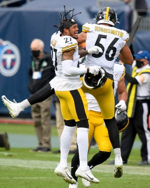 Pittsburgh Steelers safety Marcus Allen (27) and linebacker Alex Highsmith (56) celebrate defeating the Tennessee Titans at Nissan Stadium in Nashville, Tenn., Sunday, Oct. 25, 2020.