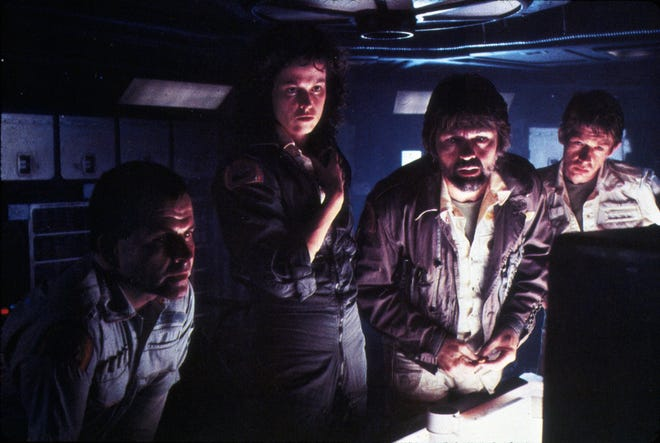 """From left, Ian Holm, Sigourney Weaver, director Ricley Scott and Tom Skerritt on the set of the movie """"Alien."""""""