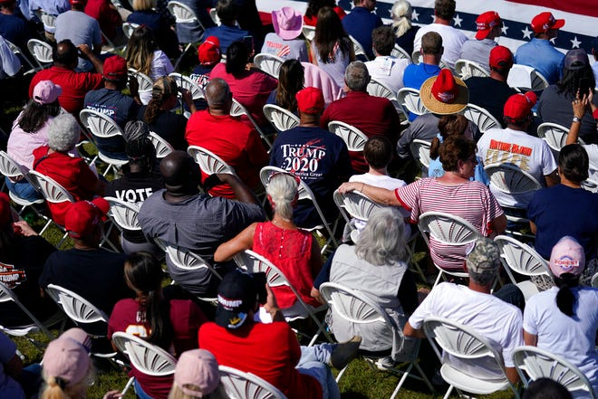 Supporters of President Donald Trump listen as he speaks during a campaign rally at Robeson County Fairgrounds, Saturday, Oct. 24, 2020, in Lumberton, N.C. (AP Photo/Evan Vucci)