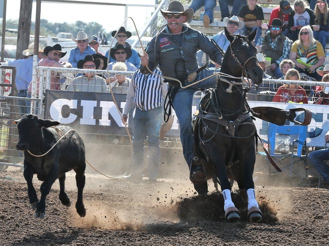 Tuf Cooper, of Decatur, Texas, competes in the 67th annual Cinch Roping Fiesta at the outdoor arena in San Angelo on Saturday, Oct. 24, 2020. Cooper won the match roping title.