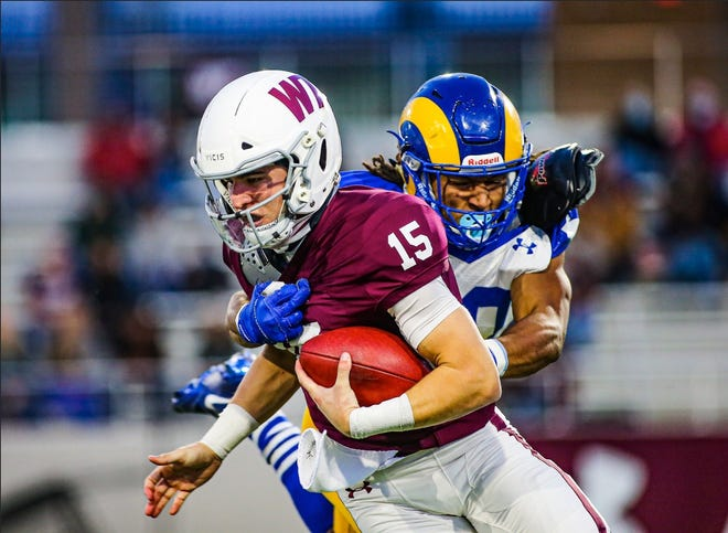 Angelo State University's Donavyn Jackson, a former San Angelo Central High School standout, tackles West Texas A&M quarterback Nick Gerber in a meeting of Lone Star Conference rivals in Canyon on Saturday, Oct. 24, 2020.