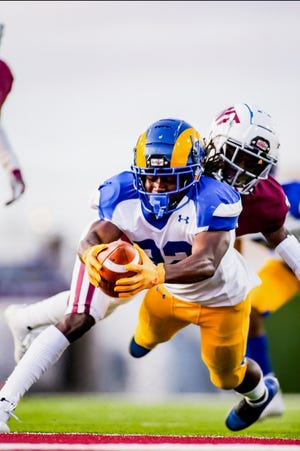 Angelo State University's Alfred Grear scores a touchdown against West Texas A&M in a meeting of Lone Star Conference rivals in Canyon on Saturday, Oct. 24, 2020.