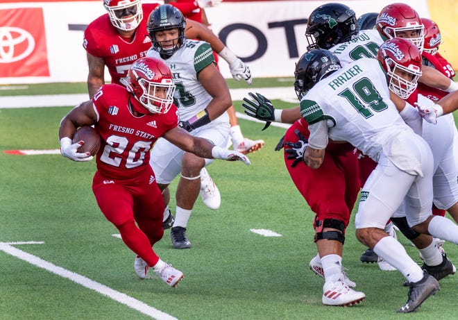 Fresno State's Ronnie Rivers, left, carries against Hawaii on Saturday, October 24, 2020.