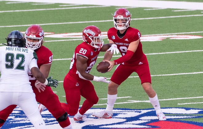 Fresno State quarterback Jake Haener hands off to Ronnie Rivers against Hawaii on Saturday, October 24, 2020.