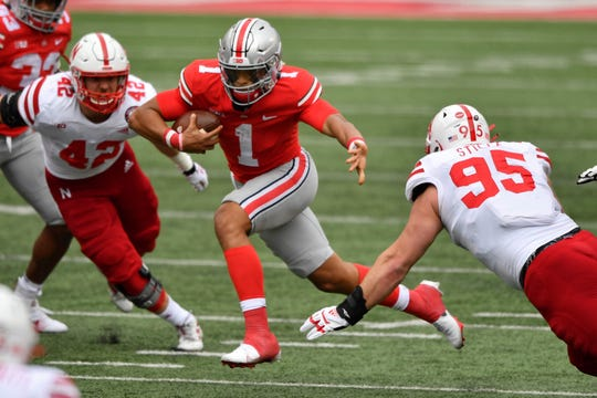 Ohio State quarterback Justin Fields runs for yardage against Nebraska during the first half at Ohio Stadium.